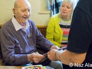 Chairman Ben Robinson presents birthday card to Francis