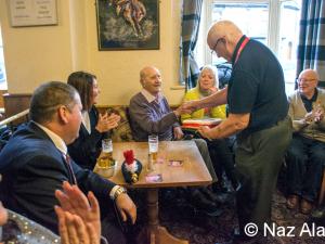Chairman presents birthday cake to Francis Brindle